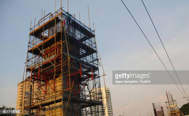 Low Angle View Of Construction Building Against Sky
