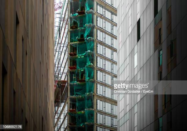 low angle view of construction site - christian soldatke stock pictures, royalty-free photos & images