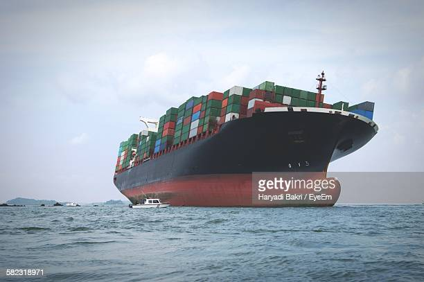 Low Angle View Of Container Ship On Sea