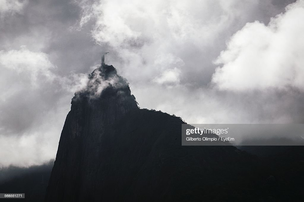 Low Angle View Of Corcovado Mountain Against Cloudy Sky : Stock Photo