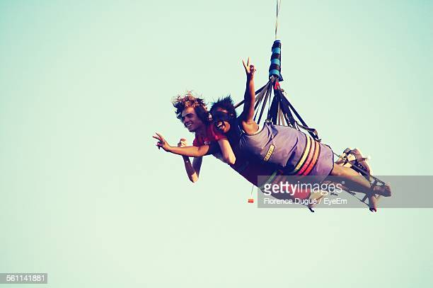 Low Angle View Of Couple Hang Gliding