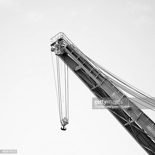 low angle view of crane against clear sky - crane stock pictures, royalty-free photos & images