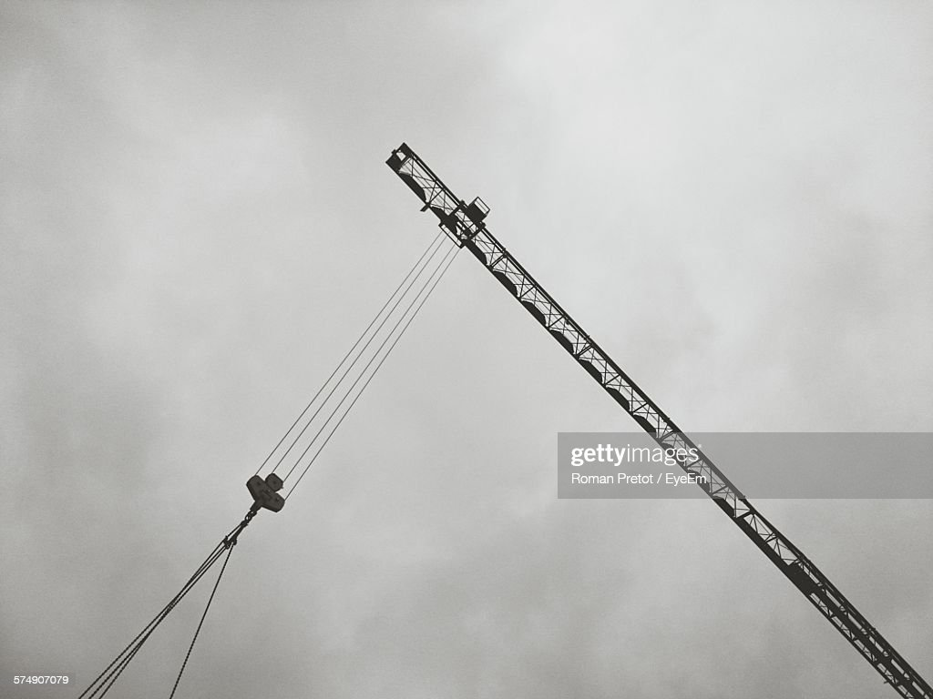 Low Angle View Of Crane At Construction Site Against Sky At Dusk : Stock-Foto