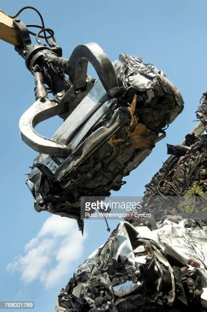 low angle view of crane carrying abandoned car - crushed stock pictures, royalty-free photos & images