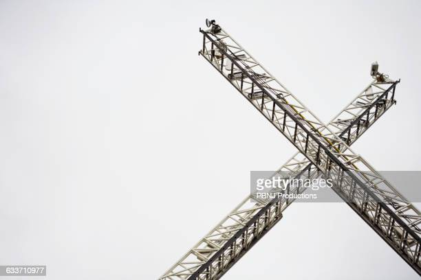 low angle view of crane ladders - letter x stock pictures, royalty-free photos & images