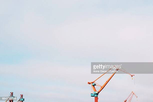 Low Angle View Of Cranes Against Clear Sky