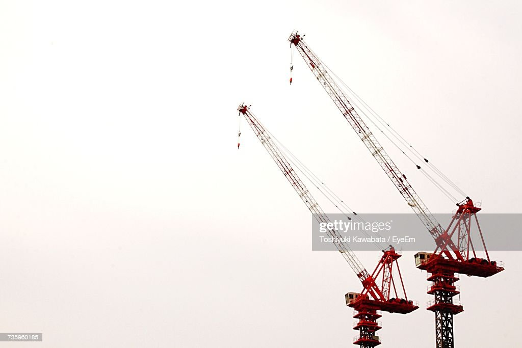 Low Angle View Of Cranes Against Clear Sky : Stock Photo