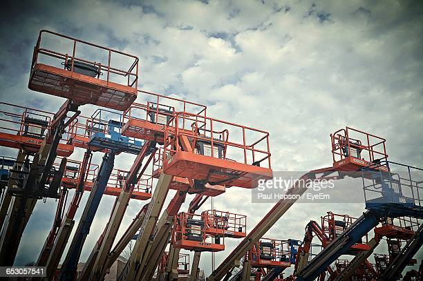 Low Angle View Of Cranes Against Sky At Construction Site