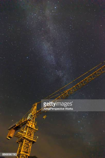 Low Angle View of Cranes and Milky way