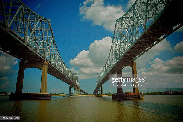 low angle view of crescent city connection bridge over mississippi river against sky - steve matten stock pictures, royalty-free photos & images
