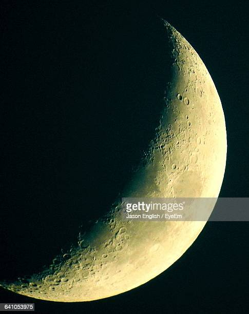 Low Angle View Of Crescent Moon In Clear Sky At Night