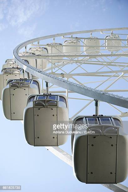 low angle view of cropped ferris wheel against sky - adriana duduleanu stock photos and pictures