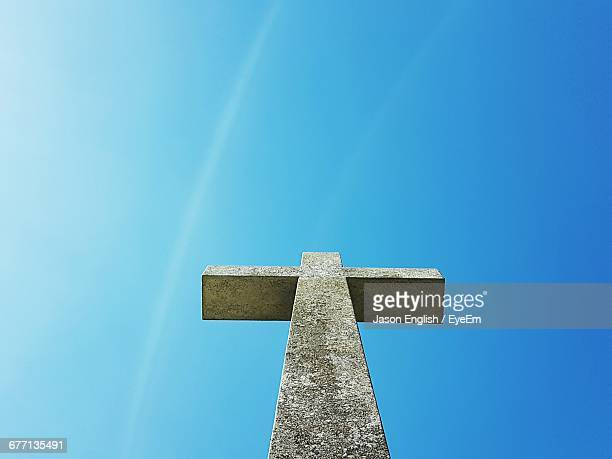 Low Angle View Of Cross Against Clear Blue Sky