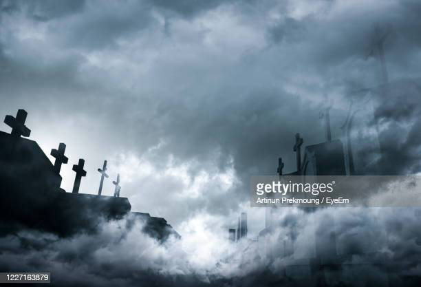 low angle view of cross against sky - death stock pictures, royalty-free photos & images