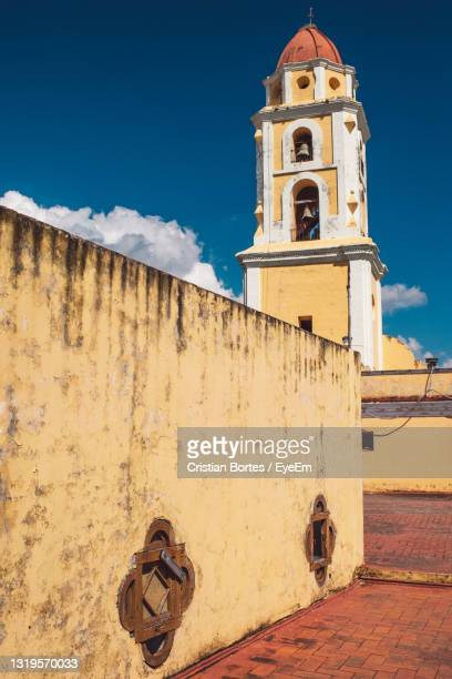 low angle view of cross on building against sky - bortes stock pictures, royalty-free photos & images