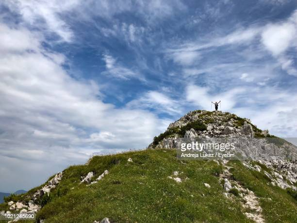 low angle view of cross on rock against sky - kranj stock pictures, royalty-free photos & images