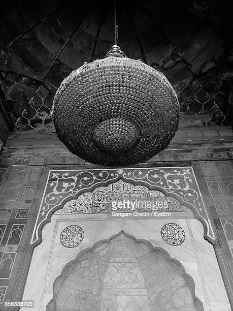 Low Angle View Of Crystal Chandelier In Mosque