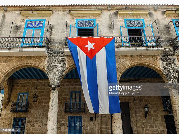 low angle view of cuban flag at building - cuban flag stock pictures, royalty-free photos & images