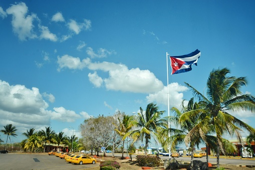 Low Angle View Of Cuban Flag Fluttering Against Blue Sky - gettyimageskorea