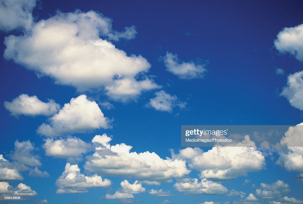 Low angle view of cumulus clouds in the blue sky : Stock Photo