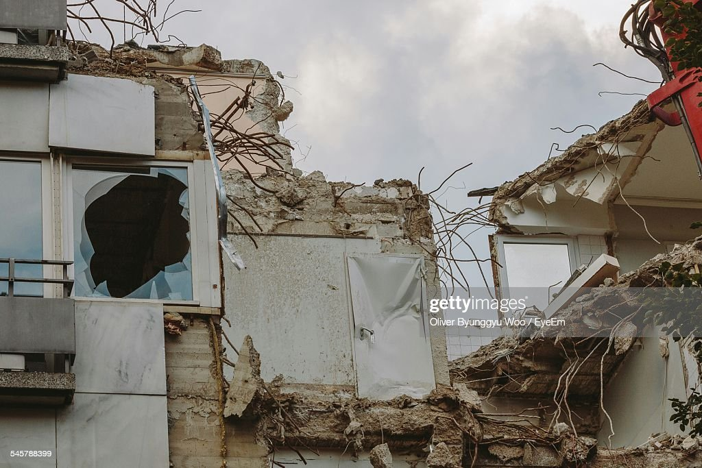 Low Angle View Of Damaged House : Stock Photo