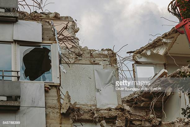 low angle view of damaged house - collapsing stock pictures, royalty-free photos & images