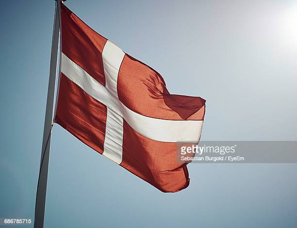 Low Angle View Of Danish Flag Against Clear Blue Sky