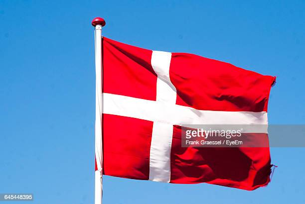 Low Angle View Of Danish Flag Against Clear Sky