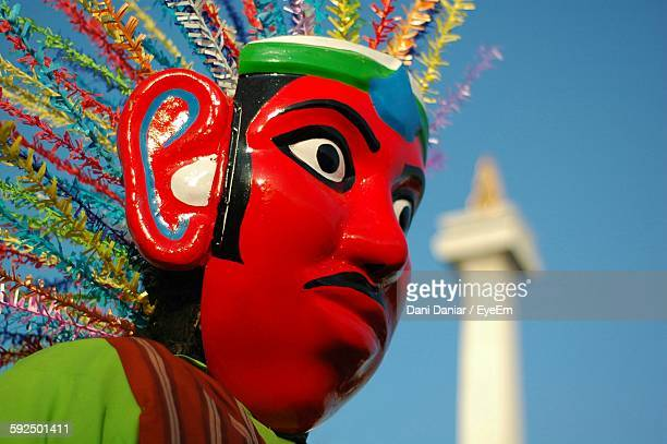 Low Angle View Of Decorated Puppet Against Sky