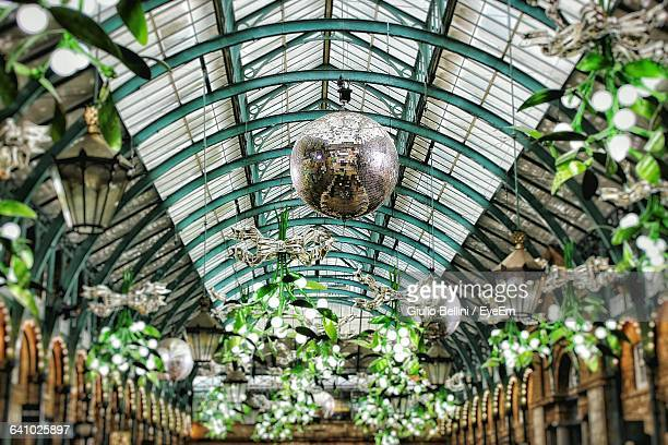 low angle view of decorations hanging at covent garden - covent garden - fotografias e filmes do acervo