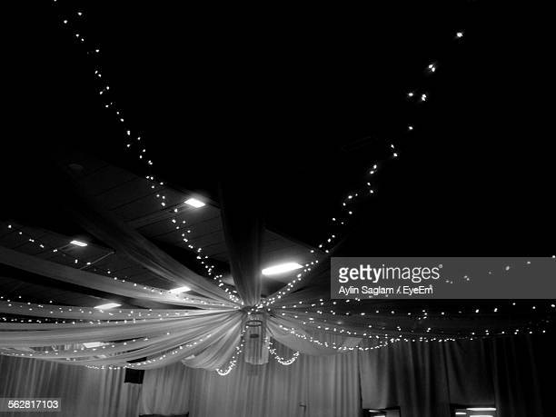 Low Angle View Of Decorations In Illuminated Room