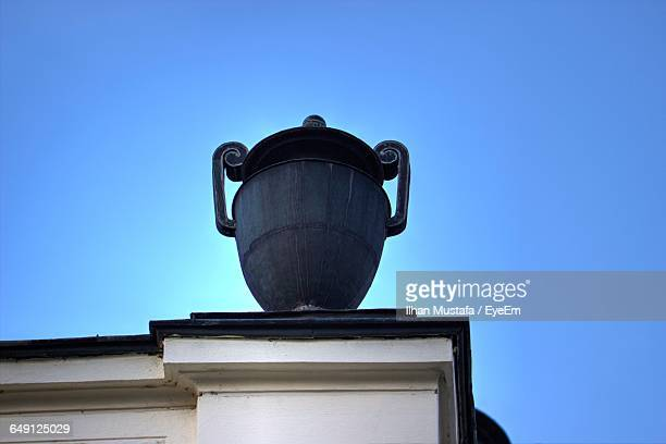 Low Angle View Of Decorative Urn On Building Against Sky