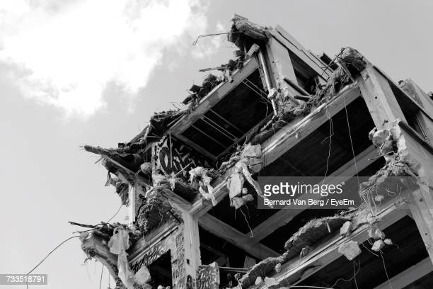 Low Angle View Of Demolished Building Against Cloudy Sky