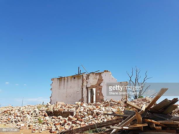 Low Angle View Of Demolished Built Structure Against Clear Blue Sky