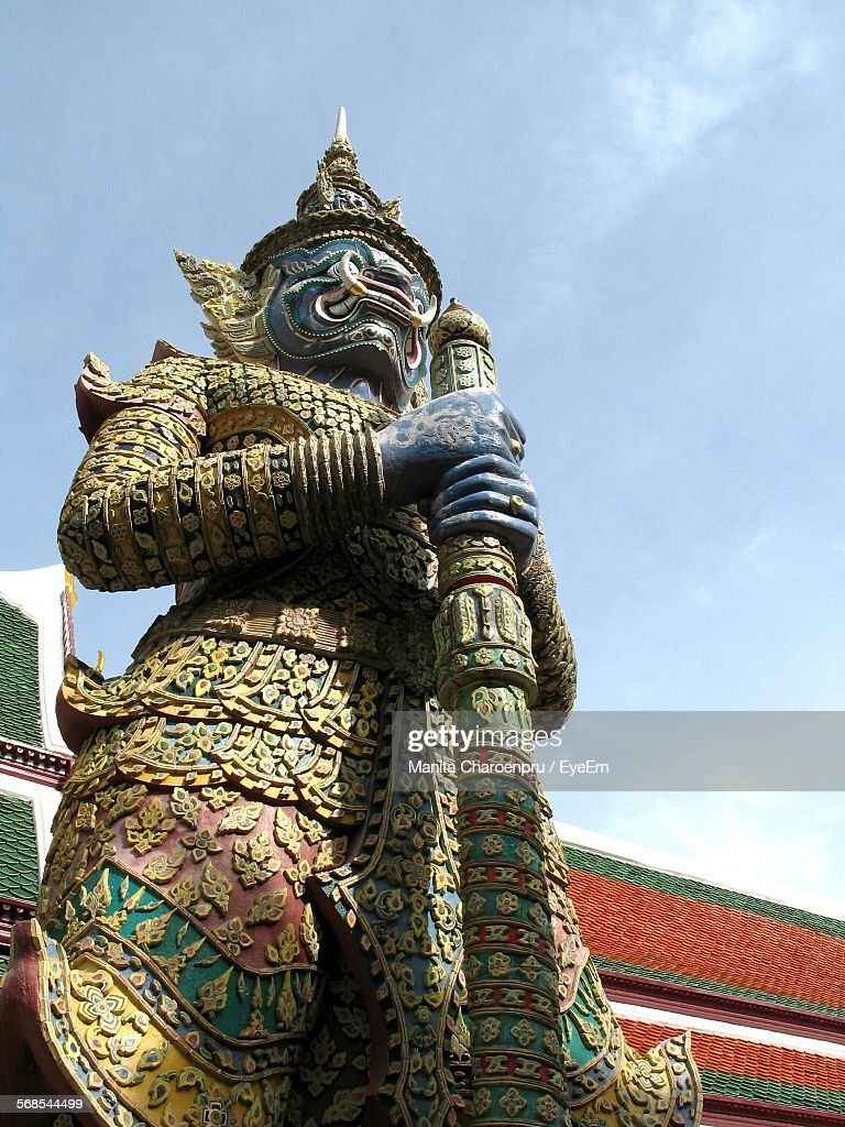 Low Angle View Of Demon Statue Against Sky At Wat Phra Kaew : Stock Photo