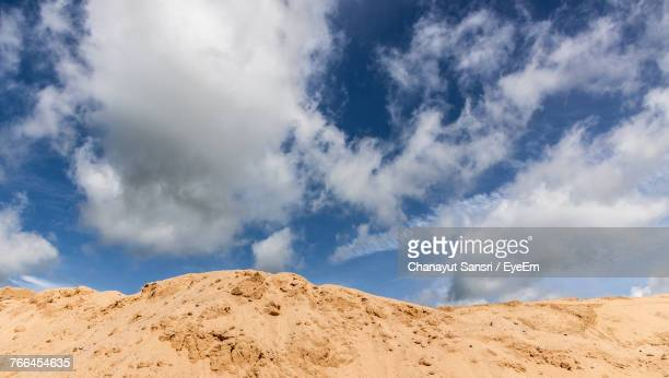 low angle view of desert against sky - chanayut stock photos and pictures