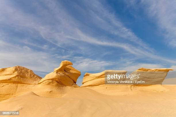 low angle view of desert against sky - rock formation stock pictures, royalty-free photos & images
