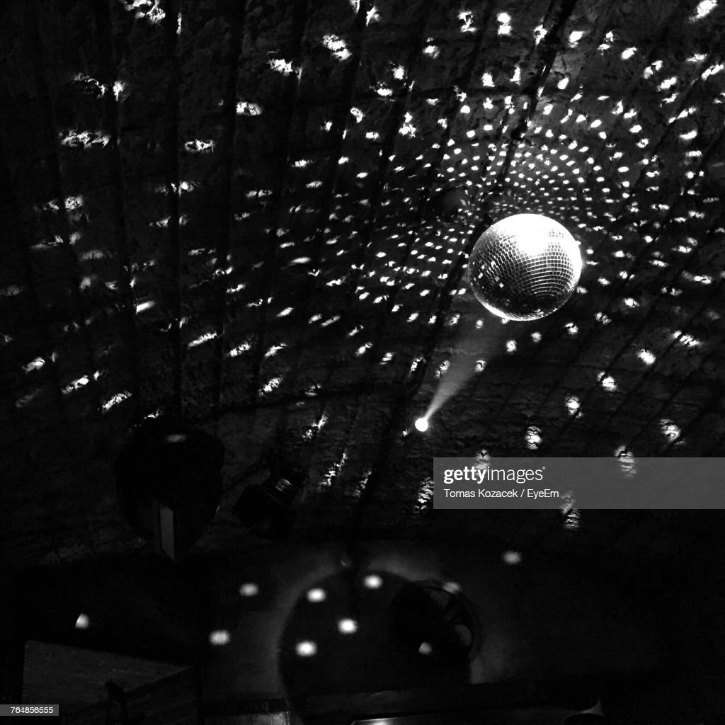 Low Angle View Of Disco Ball At Nightclub : Stock Photo