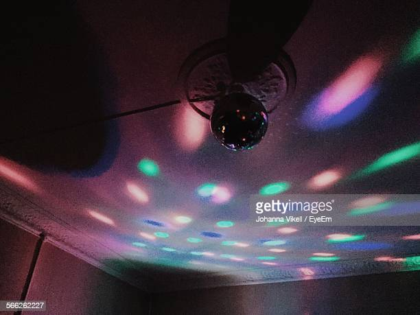 low angle view of disco ball hanging in illuminated room - room after party stock pictures, royalty-free photos & images