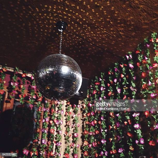 Low Angle View Of Disco Ball Hanging On Ceiling Against Decorations