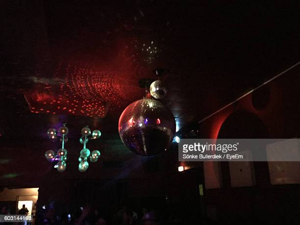 Low Angle View Of Disco Ball Hanging On Ceiling At Nightclub