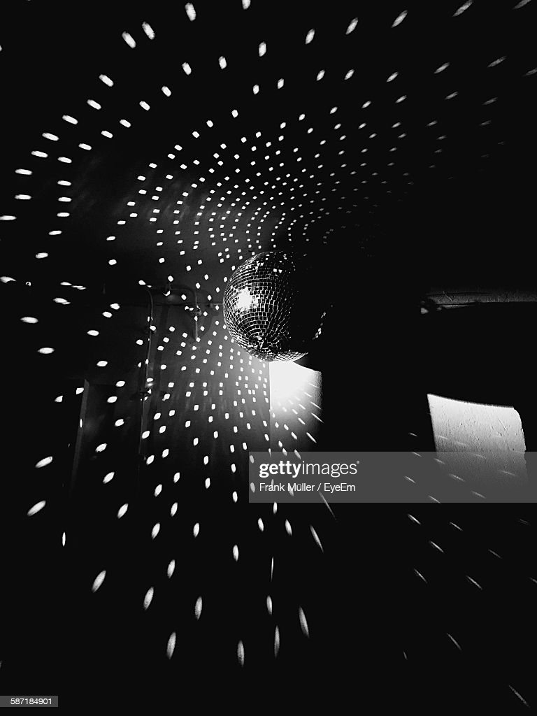 Low Angle View Of Disco Ball With Lights Hanging From Ceiling : Stock Photo