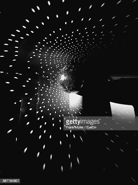 Low Angle View Of Disco Ball With Lights Hanging From Ceiling