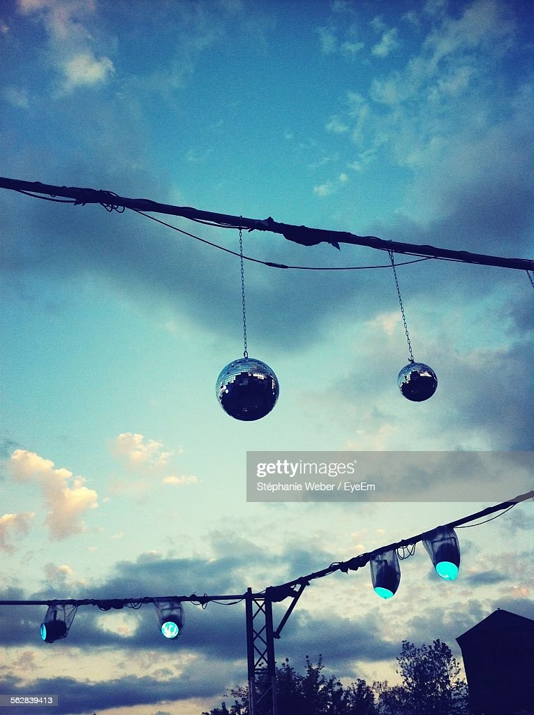 Low Angle View Of Disco Balls And Spotlights Against Sky : Stock Photo