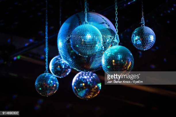 low angle view of disco balls hanging at nightclub - jan dance stock pictures, royalty-free photos & images