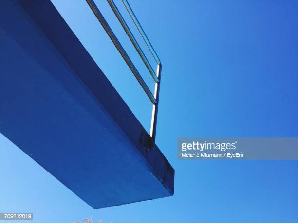 low angle view of diving platform against clear blue sky - diving platform stock pictures, royalty-free photos & images