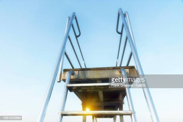 low angle view of diving platform against clear sky - diving platform stock pictures, royalty-free photos & images
