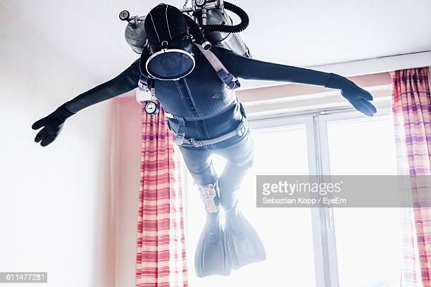 Low Angle View Of Diving Suit Hanging At Home