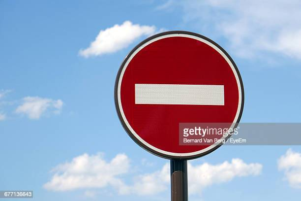 Low Angle View Of Do Not Enter Sign Against Sky