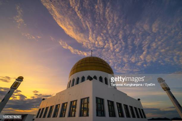 low angle view of dome against cloudy sky during sunset - provincia di songkhla foto e immagini stock